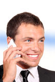 Handsome young business man on cell phone Stock Photography