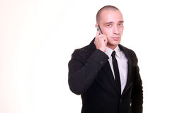 Handsome young business man on cell phone Stock Image