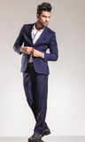 Handsome young business man closing his coat Royalty Free Stock Photos