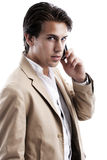 Handsome young business man on his mobile stock photo