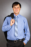 Handsome young business man holding his suit jacket on his shoul Royalty Free Stock Photography