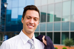 Handsome young business man at office building Royalty Free Stock Photography