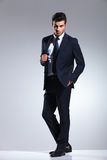 Handsome young business man pulling his jacket Royalty Free Stock Photography