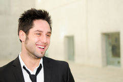 Handsome young business man smiling Stock Images