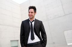 Handsome young business man smiling Stock Photos