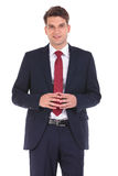 Handsome young business man smiling Royalty Free Stock Photos