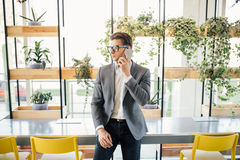 Handsome young business man speak on phone in modern office Royalty Free Stock Photo