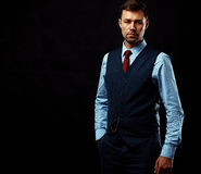 Handsome young business man standing on black Royalty Free Stock Image