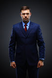 Handsome young business man standing on black Royalty Free Stock Photo