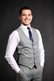 Handsome young business man standing on black Royalty Free Stock Photos