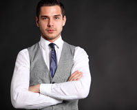 Handsome young business man standing on black Stock Photos