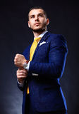 Handsome young business man standing on black Royalty Free Stock Images