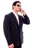 Handsome young business man talking on phone Stock Images