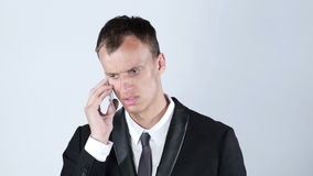 Handsome young business man talking on smartphone. Urban male professional in his 20s.Talented Man, Creative Designer, freelancer, employee, worker stock footage