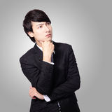 Handsome young business man think Royalty Free Stock Photo
