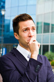 Handsome young business man thinking Royalty Free Stock Photography