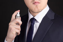 Handsome young business man using perfume Stock Photo