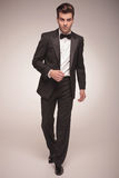 Handsome young business man walking Royalty Free Stock Image