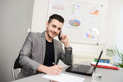 Handsome young business man working in office with casual cothes Royalty Free Stock Image