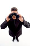 Handsome young businessman with  binoculars Royalty Free Stock Photo