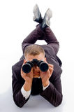 Handsome young businessman and binoculars Stock Image