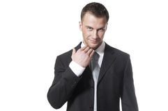 Handsome young businessman in black suit stock images