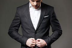 Handsome young businessman in black suit and white shirt Stock Photography