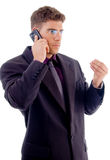 Handsome young businessman busy with cell phone Stock Photo