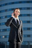 Handsome young businessman calling by mobile phone Royalty Free Stock Photography