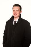 Handsome young businessman in a coat  isolated Royalty Free Stock Photos