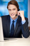 Handsome young businessman communicating Stock Photo