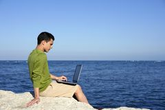 Handsome young businessman computer beach Stock Photos