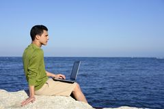 Handsome young businessman computer beach Stock Photography