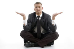 Handsome young businessman doing yoga Stock Photos
