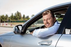 Handsome young businessman is driving his car Royalty Free Stock Photography