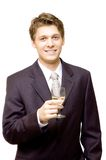 Handsome young businessman with a glass  Stock Images