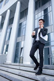 Handsome young businessman is going out from his Stock Photography