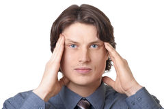 Handsome young businessman having a headache Stock Photo