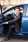 Handsome young businessman in his new car Stock Photos