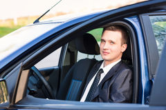 Handsome young businessman in his new car Royalty Free Stock Photos
