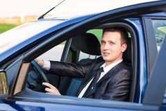 Handsome young businessman in his new car Stock Photography