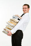 Handsome young businessman holding stack of books Royalty Free Stock Photos