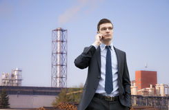 Handsome young businessman on the industrial building background Stock Photography
