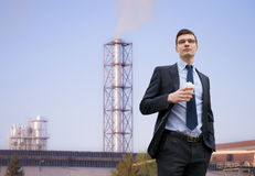 Handsome young businessman on the industrial building background Stock Photos