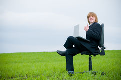 Handsome young businessman with laptop Royalty Free Stock Photo