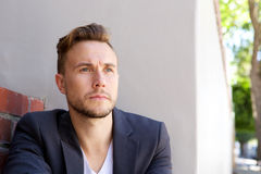 Handsome young businessman looking away Stock Images