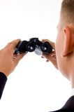 Handsome young businessman looking at binoculars Stock Photography