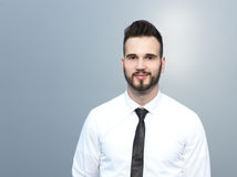Handsome young businessman looking confidently Stock Photos