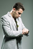 Handsome young businessman looking at his watch Royalty Free Stock Photos