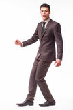 Handsome young businessman  with luck in suit Stock Image